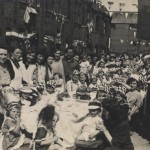 Street party in Otley Road, showing West Ham Stadium in background