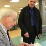 Colin Lyle signing a book for a current Tate & Lyle worker